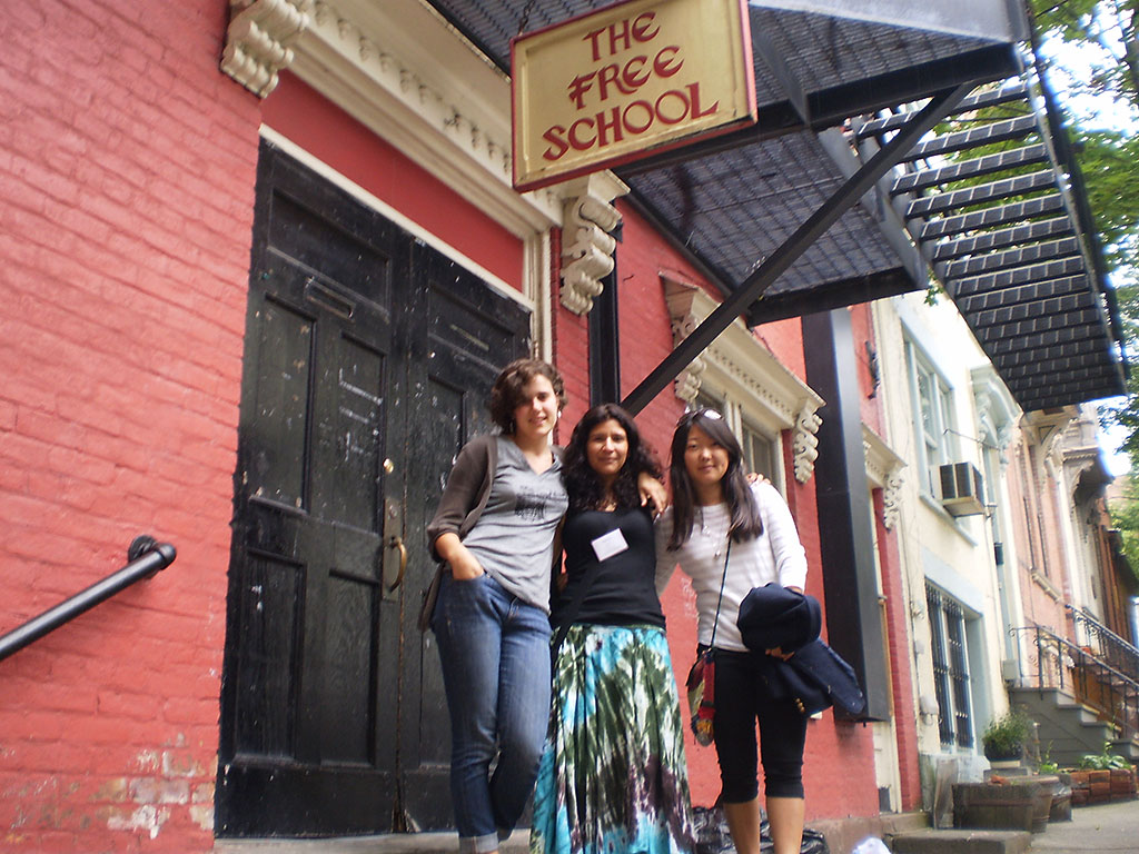 Teachers Erin Cisewski, Maydée Aguilar and Naomi Watanabe in front of The Free School in Albany, New York during the 2010 AERO Conference.